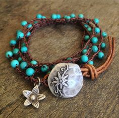 Beautiful turquoise gemstone beads are crocheted onto dark brown nylon cord featuring a stunning silver finished flower button clasp and