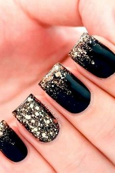 22 Black Nails That Look Edgy and Chic - Glossy black with a gold glitter fade.