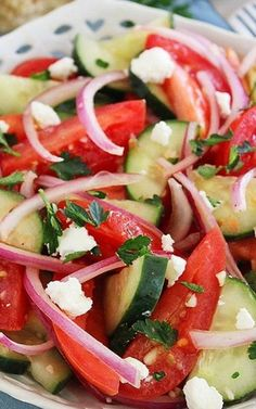 Easy Tomato, Cucumber and Red Onion Salad  Ingredients:  4 medium Roma tomatoes, cut into wedges 1 medium cucumber, halved lengthwise and thinly sliced 1/2 red onion, halved lengthwise and thinly sliced 2 garlic cloves, minced 2 Tablespoons good-quality olive oil 2 Tablespoons red wine vinegar Coarse salt and black pepper 2 Tbsp. chopped fresh parsley 1/4 cup crumbled feta, for serving
