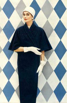 Anne Gunning in coat by La Vigna, 1957