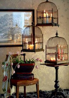Love the illuminating candles in the birdcages... http://bucca651.tumblr.com/post/72370662897