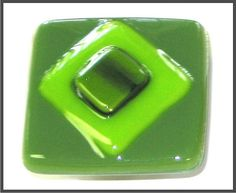 "Fused Glass Tiles in Lime Green and Olive Green. This glass tile has multiple green colors with metallic flakes in the diamond center.   Fused Glass Cabinet Knobs and Pulls.    Glass Cabinet Knob is 1-1/2"" square and comes attached cabinet hardware. You Be sure to see our bright and festive home decor items at www.CreativeHomeDecorations.com"