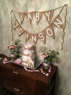 Burlap banner on twine, honest co diaper cake, Sophie giraffe, pink carnations in mason jars with pink ribbon and lace
