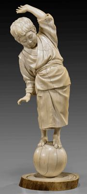 Antique Japanese Tokyo School ivory figure of a boy balancing on a ball; attributed to Yoshida Homei; 14.25 inches high