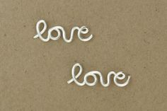 Love Earrings : Sterling Silver Plated Love Stud Earrings, Cartilage, Pair, Word, Handwritten, Cursive, Affirmation, Ear Cuff. $32.00, via Etsy. -- JUST ordered the pair!! SO excited to get them :D