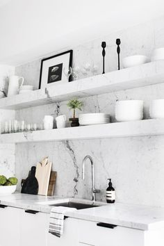 """No renovation is complete without its challenges. """"Our first month living here, we didn't have a kitchen,"""" she explains. """"We couldn't make anything except coffee and washed our mugs in the..."""