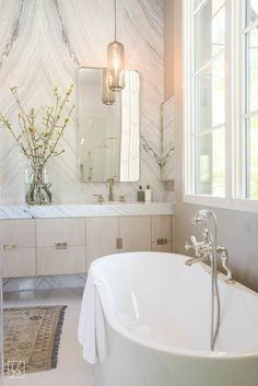 Light Marble Backsplash | Light and Airy Bathroom | Large Window in Bathroom | Free-Standing Tub