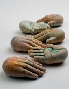 """Hands of Love"" Ceramic rattles."