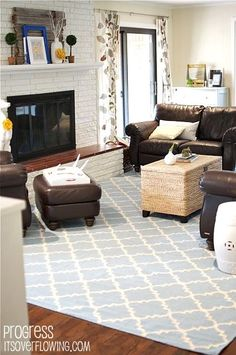Family Room with blue rug and yellow accents Brown couches and rattan coffee ta. Family Room with blue rug and yellow accents Brown couches and rattan coffee table Details at Its Brown And Blue Living Room, Brown Couch Living Room, Home Living Room, Living Room Decor, Kitchen Living, Apartment Living, Family Room Decorating, Family Room Design, Decorating Ideas
