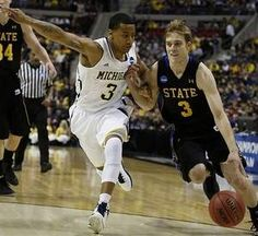 Michigan's Trey Burke guards South Dakota State's Nate Wolters on March 21, 2013, in the second round of the NCAA tournament at the Palace of Auburn Hills.
