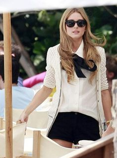 Olivia Palmero - Plain white button-up, thick black ribbon (heavy-ish material) tied in a big bow around collar