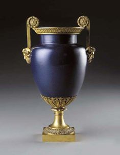 *AN EMPIRE ORMOLU-MOUNTED SEVRES (HARD PASTE) DARK-BLUE GROUND OVIFORM VASE. THE MOUNTS ATTRIBUTED TO PIERRE-PHILIPPE THOMIRE, THE PORCELAIN CIRCA 1810.