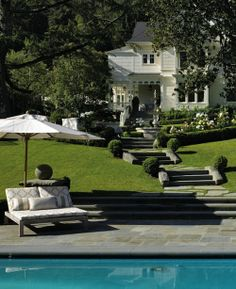 .love this house setting,  I would place urns along the steps instead of boxwoods