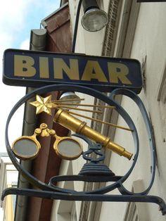 Sign of Optiker Binar (optician Binar's shop) in Knieperstraße, Hanseatic Town of Stralsund, district of Vorpommern-Rügen, Mecklenburg-Vorpommern (Mecklenburg-Western Pomerania), Germany. Cnc Router, Storefront Signage, Cafe Sign, Pub Signs, Business Signs, Advertising Signs, Store Signs, Hanging Signs, Sign Design