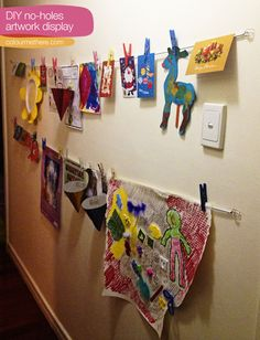 No-hole kids hanging art display. Uses coated wire and 3M removeable hooks but you could use anything similar.
