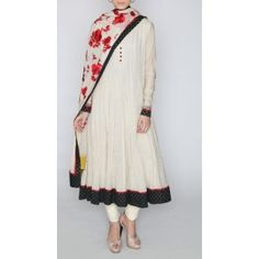An offwhite color suit in jute fabric with a cotton churidar and dupatta