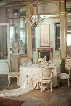 French deco dining room - Love the mirrored & gilded wall!