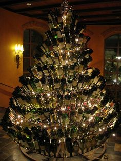 Wine bottle christmas tree. I love this, right up my alley. Wine drinking alley, that is. Ha. All I can picture is one of the pups running into it though, and glass EVERYWHERE.
