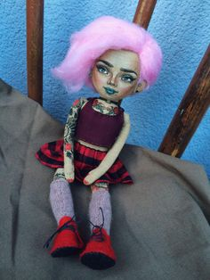 A personal favourite from my Etsy shop https://www.etsy.com/listing/473624838/cloth-doll-baby-pinkhair-with-tattoos