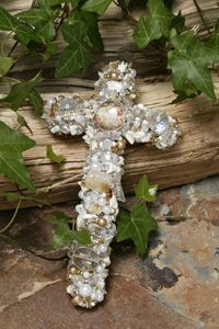 semi-precious stones, mother of pearl, and glass cross