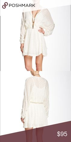 Free People Snug Bug Faux Wrap Dress Long sleeved, cross-over faux wrap mini dress. Semi-sheer with a snap detachable slip. Drawstring waist with side tassel ties, raw edge cuffs and hem. Color is ivory. Free People Dresses Mini