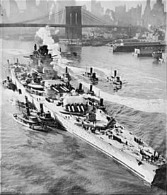 Richelieu (cuirassé de 1939) - French battleship in New York. Maneuvered by tugboats up New York's East River, the mighty 35,000-ton Richelieu, largest French battleship, is on its way to a U.S. navy yard to be repaired and refitted. The slightly damaged warship is in the United States with three other French men-of-war.
