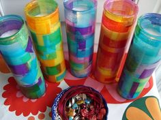 ever make those 'stained glass' votives with tissue paper when you were a kid? this project is a twist on that, using novena (altar) candles instead. not only are they super inexpensive (usually less than $2) each, but they last forever and the color becomes even more vibrant as the candles burn down. @ Heart-2-HomeHeart-2-Home