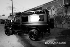 BLACK 110 SAVAGE BY LAND ROVERS UK LTD USA D110 DEFENDER PRE OWNED IMPORT
