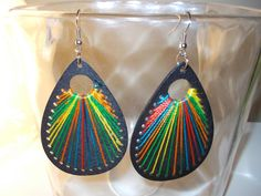 Black visual earrings by MADDAfricanJewelry on Etsy