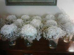 Hydrangea and babies breath in mason jars with burlap
