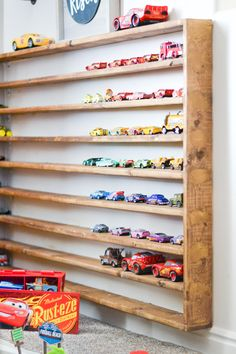 Learn how to DIY Hot Wheels Storage that is so easy and will fit in any space you own. Perfect for any diecast car storage. Hot Wheels Storage, Toy Car Storage, Hot Wheels Display, Toy Display, Display Shelves, Vitrine Pour Collection, Matchbox Car Storage, Diy Toys Car, Toy Rooms