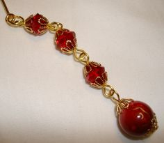 Red glass and acrylic beads to make this beautiful gold hijab pin.