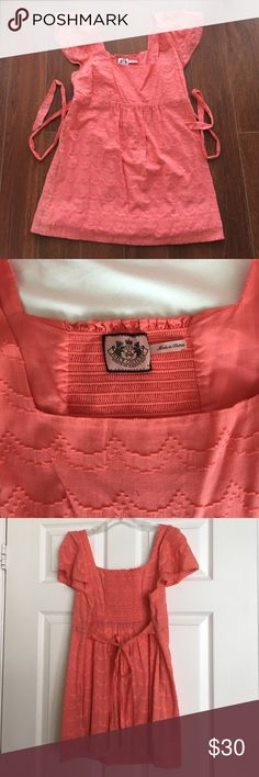Juicy Couture sz md coral printed tunic w/ print This is a Juicy Couture size medium coral printed tunic with a zip up side and ties in the back. The sleeves are cap sleeves. It is 100% cotton and in excellent condition. If you have any questions please ask! Juicy Couture Tops Tunics