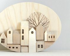 wood wall art #house #wood #art  I really like this simple wall plaque. Probably made from wood scraps  then wood burned to pickout the features. Abstract but very warm at the same time. That tree is brilliant. A fine piece of work ;)