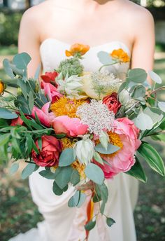 Bouquets filled with eucalyptus, Queen Anne's lace, peonies, ranunculus // Aaron and Jillian Photography