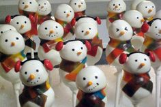 snowmen! I used fruit rollups for the scarves, some had mouths, some had earmuffs. I found tiny candy carrots for the nose, and used the edible marker for the eyes.