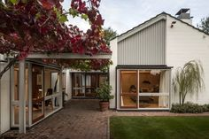 """A steel cantilevered pergola on the northwest elevation of the house creates a sheltered hallway and patio. """"The architect, Sir Miles Warren, consciously designed homes with a sense of containment and enclosure to protect the inhabitants from the cold, flat Canterbury plain where Christchurch is located,"""""""