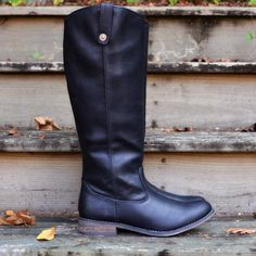 tall black riding boots