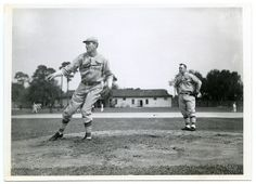 St. Louis Cardinal Dizzy Dean pitching while manager, Frankie Frisch looks on…