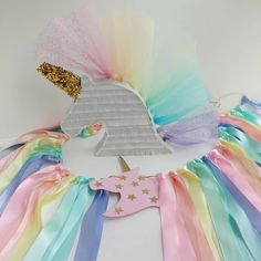 "Everything's coming up rainbows...and unicorns!  My pastel rainbow tulle unicorn pinata has a new friend. This satin ribbon unicorn highchair garland is headed to a lovely little birthday . (45"" long ribbon garland for highchair: $25. Custom lengths can be requested. Unicorn pinata with rainbow tulle mane and confetti: $40. Order via email in profile.) #handcraftedparties #unicornparty #unicorns #rainbowsandunicorns #rainbowparty #unicornpinata #pinata #minipinata #garland #ribbongarland…"