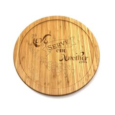"""This is a beautiful wood finished lazy susan turntable. This lazy susan has the phrase """"by love serve one another"""" engraved on it. This turntable would be a great addition to any table for any occasion. It makes it easy to reach silverware, plates, condiments, or even serve food to a large group around a table. This turntable has a 14"""" outside diameter, with approx. a 1"""" lip.*Color will vary slightly from image due to screen settings.*Product will vary slightly from product to product due to gra Round Dining Table, A Table, Lazy Susan Table, Centerpieces, Table Decorations, Thing 1, Acrylic Sheets, Bamboo Cutting Board, Turntable"""