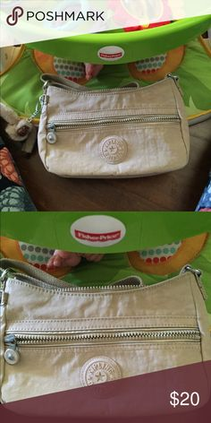NWOT Kipling purse This purse is a sand color. I don't really know how to explain it lol. Will only be avail to 9/19. Kipling Bags Crossbody Bags