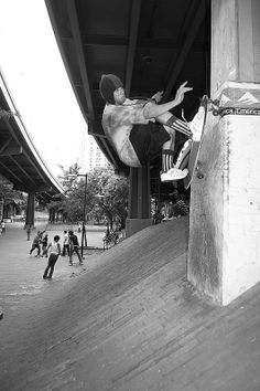 Mark Gonzales with a long board frontside wall ride at the Brooklyn Banks, 2009, I think. Photo by Waters.