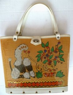 Plastic covered poodle and tree bucket bag.