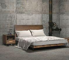 chambre à coucher avec des murs en béton