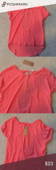 NWT open-back salmon colored blouse. Brand new Peach/salmon colored blouse. Cut out back. Zipper on front. 100% polyester. Francesca's Collections Tops