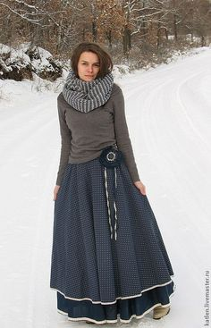 Long, full skirt - dual layer or maybe a petticoat, plain jersey shirt and infinity scarf, with boots. Winter skirt.