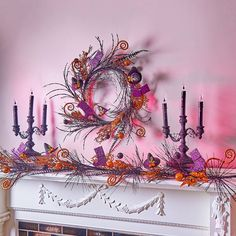 Glittery and whimsical, this festive Halloween garland and wreath are adorned with leaves, witches' hats and boots, and other botanical delights. Add classic Halloween style to your door, mantel, or staircase.