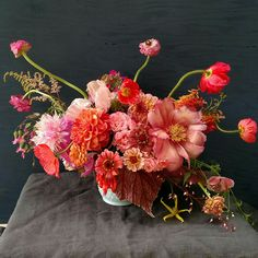 Peonies, Poppies, Ranunculus rarely intersect in the season with zinnias and dahlias, but I made it happen!