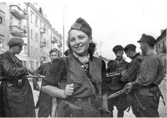 Vilna, Poland, The partisan Rachel Rudinsky with a group of armed partisans during the liberation of the city, 1944.